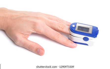 Pulse oximeter with hand of patient isolated on white background.