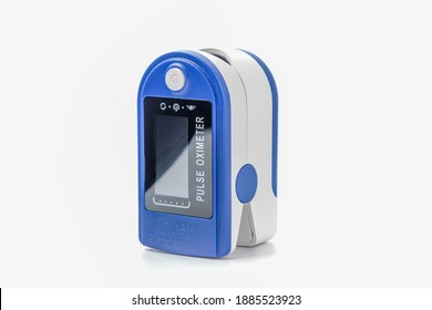 Pulse oximeter for measuring blood oxygenation and prevention of Cavid-19 at home on a white background, monitoring the state of lung damage in a pandemic