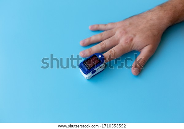 Pulse Oximeter On a male finger. Man using Oximeter. Healthy Concept