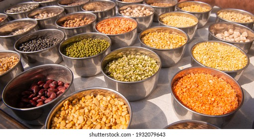 pulses and cereals grain placed in steel cup at wholesale market of old Delhi