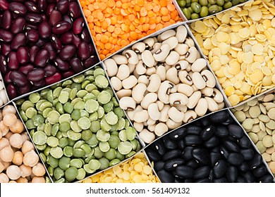 Pulses food background, assortment  - legume, kidney beans, peas, lentils in square cells closeup top view. Healthy protein food.