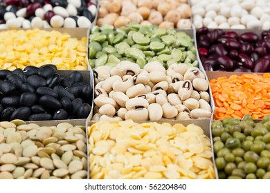 Pulses food background, assortment  - legume, kidney beans, peas, lentils in square cells macro. Healthy protein food.
