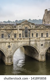 Pulteney Bridge (1774) crosses River Avon in Bath, England. Designed by Robert Adam in a Palladian style, it is one of only four bridges in the world with shops across its full span on both sides.