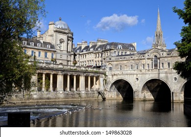 Pulteney Bridge and the River Avon in Bath.  St Michael's Church can be seen in the background.
