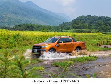 Puluong, Vietnam - June 8, 2018: Ford Ranger Wildtrak 3.2L is crossing stream in test drive, Vietnam.