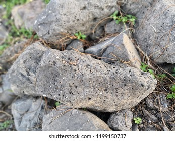 Pumice rock is extremely porous igneous rock that forms during explosive volcanic eruptions. It is used as aggregate in lightweight concrete, as landscaping aggregate.