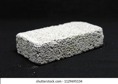 Pumice stone isolated on black background