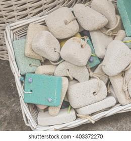 pumice stone in the souvenir shop, colorful pumice stone, Different colors of pumice stone in shop,hanging decoration in the souvenir shop, Color stone pumice for scrub,