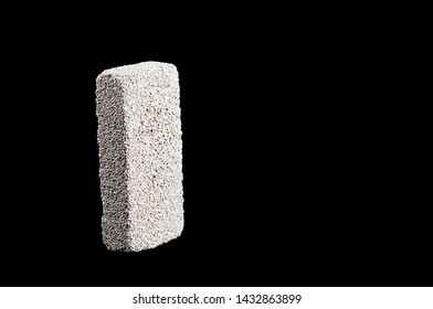 pumice stone for washing heels on a black background isolate