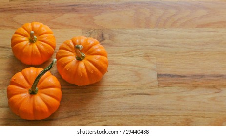 Pumkin on wooden floor background.