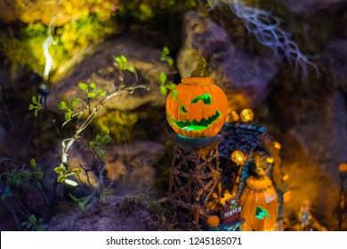 A pumkin in a scary halloween town