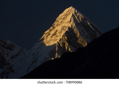 Pumori (7161m) at sunset. A distant view from a place above the Ama Dablam Base Camp. Sagarmatha National Park - UNESCO World Heritage Site. Everest Region, Solukhumbu, Nepal.
