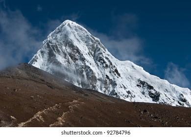 Pumori, Kala Patthar and cloudy sky in Himalayas. Nepal (shot on height 5100-5200 m)