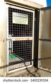 Pump house entry door at the Merewether salt water baths, Newcastle, NSW Australia
