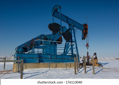 Pump Jack and Service Worker, Alberta Canada