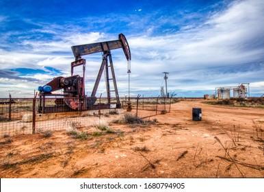 Pump jack and storage tanks