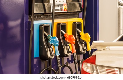 Pump nozzles in a service station, Gas