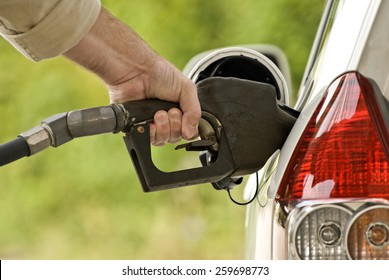 Pumping Gas At Gas Pump/ Close up of man pumping gas in car