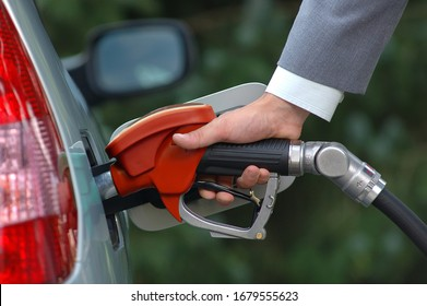 Pumping petrol with fuel pump. Vehicle fueling facility at petrol station.