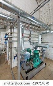 Pumping station in an industrial gas boiler house with a multitude of pipes; Pumps and valves.