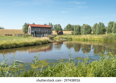 The pumping station Schuddebeurs built around 1960 near the Dutch village of Lage Zwaluwe in North Brabant ensures the water management of the surrounding polder.