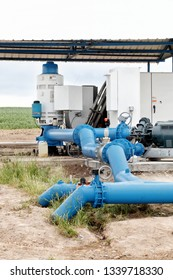 A pumping station where water is pumped from a ground well, and distributed to multiple agricultural sprinklers systems in the fertile farm fields of Idaho.