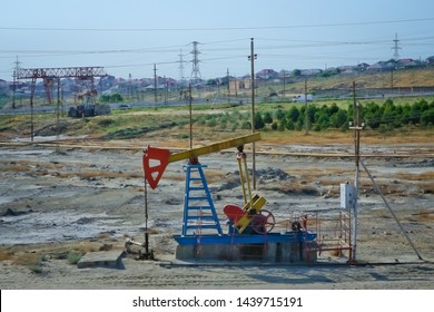 Pumping unit is working in oil field .Beam type crank balance pumping unit . Beam type crank balance pumping unit . Oil-extracting enterprise, oilfield