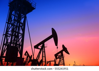 Pumping unit is working in oil field of the sunset