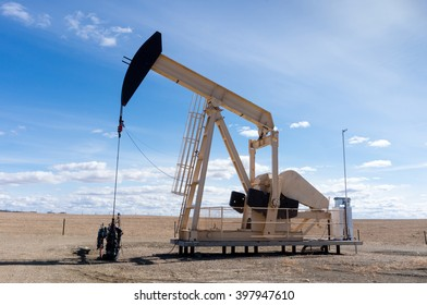 A pumpjack extracting oil out of an overground well in rural Alberta, Canada. These jacks can extract between 5 to 40 liters of crude oil and water emulsion at each stroke.