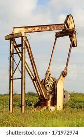 pumpjack, nodding donkey,  horsehead , rocking horse, beam, dinosaur, sucker rod, grasshopper, Big Texan, thirsty bird, jack pump a reciprocating piston pump in an oil well. in eastern Texas