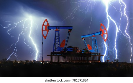 Pumpjack in an oil field during a thunderstorm and lightning.