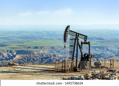 A pumpjack or pump jack in the oil field. A pumpjack is the overground drive for a reciprocating piston pump in an oil well.