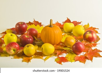 pumpkin and apples on leaves