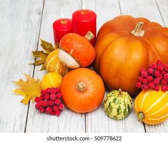 Pumpkin and autumn  leaves on a old wooden table