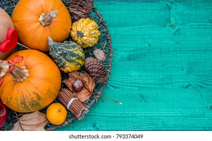 Pumpkin and autumn leaves on a old wooden table, fruits of fall, decorations
