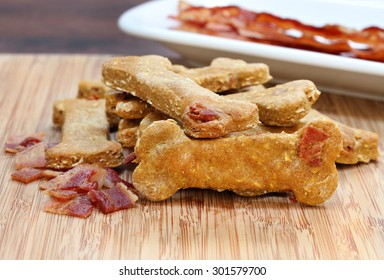 Pumpkin, bacon dog biscuits on a cutting board.  A homemade and healthy treat for your dog.