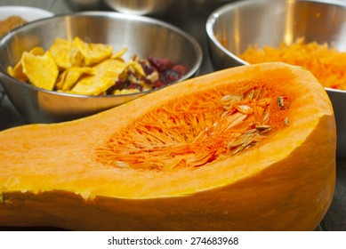 pumpkin bread ingredients in alloy mixing bowls, aged wood table background