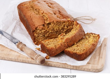 Pumpkin bread loaf over white wooden background closeup