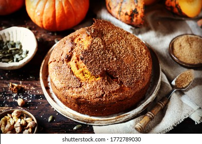 Pumpkin cake with brown sugar on a dark wooden background, still life