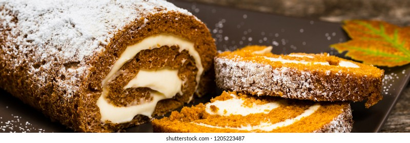 Pumpkin Cake Roll with Cream Cheese Filling. Panoramic image. Selective focus.