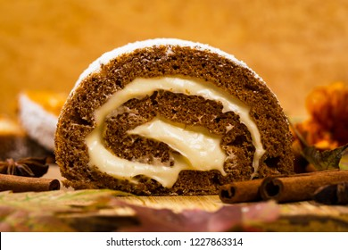 Pumpkin Cake Roll with Cream Cheese Filling. Autumn Baking. Selective focus.