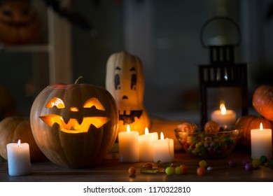Pumpkin and candy on the table in the celebration of Halloween