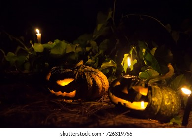 Pumpkin carved and adorned with candles in the dark, Is a symbol of Halloween