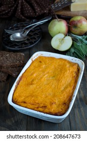 Pumpkin casserole with smoked sausages and apples