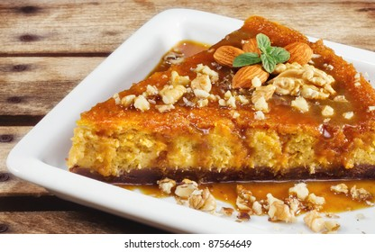 Pumpkin cheesecake with almonds and walnuts  (shallow dof)