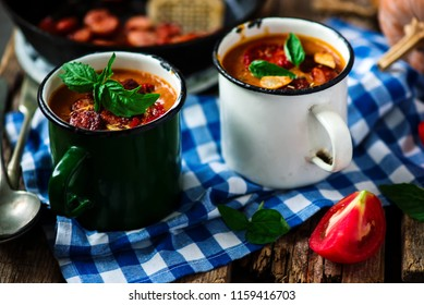 Pumpkin and chorizo soup..style rustic.selective focus