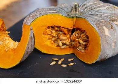 Pumpkin closeup on a black background.