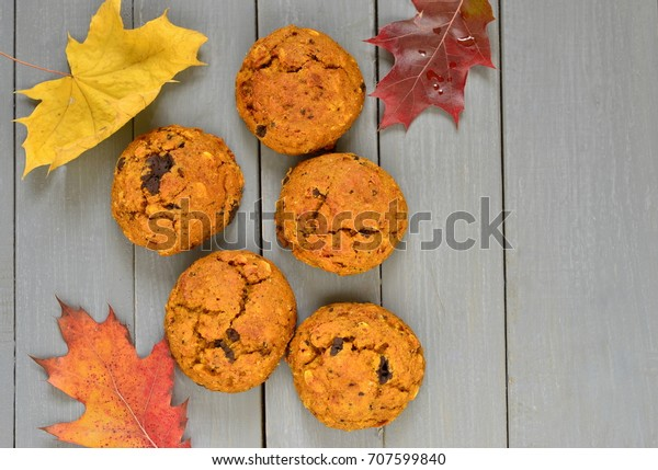 Pumpkin cookies with chocolate chips, top view, copy space