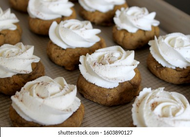 Pumpkin cookies with piped buttercream icing rosettes