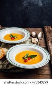 Pumpkin cream soup on a wooden table